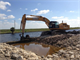 The old Tamiami Trail roadway was broken through on May 15 during roadway removal efforts as part of the Tamiami Trail Modifications project in Miami, Fla. The road has served as a longstanding physical barrier, preventing water from flowing into Everglades National Park. While there is still much more work to be done on the project, removal of the one-mile section of roadway will bring the project one step closer to completion. For additional information on the project visit: http://bit.ly/TamiamiTrail